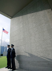 US Airforce personnel stand beside a wall during the 60th anniversary of the Liberation of the ...