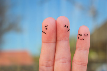 Fingers art of couple after an argument looking in different directions.  Idea of family during conflict. Concept of parents quarrel, child was upset.