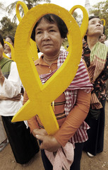 A Cambodian woman holds a a symbol for freedom of expression in Phnom Penh