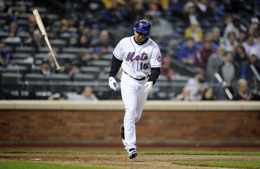 New York Mets' Beltran flips the bat away after drawing a walk during an MLB exhibition baseball game against Boston Red Sox at Citi Field in Flushing