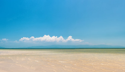 Beach with white sand and blue sky