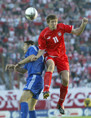 RASIAK OF POLAND FIGHTS FOR THE BALL AGAINST PAPADOPOULIS FROM GREECE IN SZCZECIN.