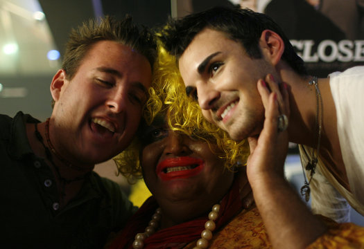 Knipp, as the blackface character Shirley Q. Liquor, brings J.P. Davis and Drew Gillum in close for a photograph after his show at Fusion night club in Louisville