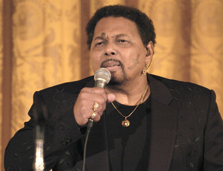 Singer Neville performs during the entertainment portion of the State Dinner for the nation's governors in Washington
