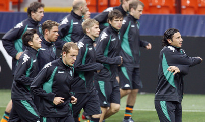 Pizarro of Werder Bremen leads team mates during a training session at San Siro stadium in Milan