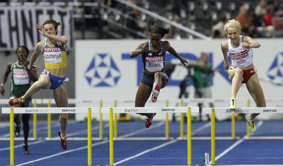 Rabchenyuk of Ukraine, Williams of the U.S. and Jesien of Poland compete in the women's 400 metres hurdles semi-final heats during the world athletics championships at the Olympic stadium in Berlin