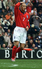 ENGLAND'S BECKHAM HOLDS HIS HEAD DURING WORLD CUP QUALIFIER AGAINST FINLAND AT ANFIELD.