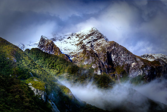 Snow Capped Peak in the Clouds