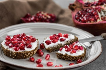 bread with cream cheese and pomegranate seeds.bread with cream cheese and pomegranate seeds.