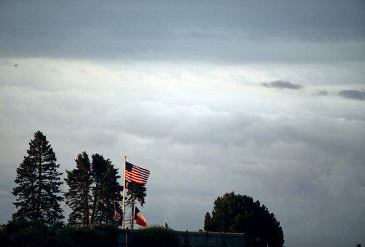 Light hits a U.S. flag at the home of former U.S. President George Herbert Walker Bush in Kennebunkport, Maine