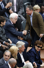 Former French Socialist PM Jospin shakes hands with Jean Todt during the French Open tennis tournament in Paris