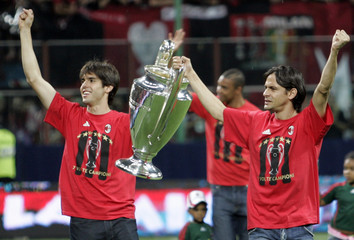 AC Milan's Ricardo Kaka and Filippo Inzaghi lift the Champions League trophy during a celebratory event in Milan