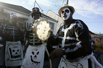 Members of the Northside Skeleton Gang chant in the Treme neighborhood of New Orleans