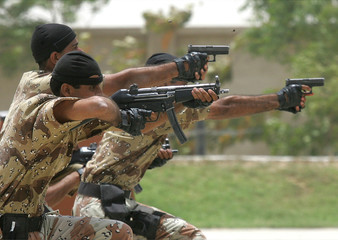 Members of Pakistan Ranger's Anti Terrorist Force exhibit their skills during demonstration in Karachi