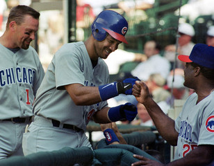 CUBS' RODRIGUEZ GETS GREETED BY MANGER AFTER GRAND SLAM AGAINST ASTROS.