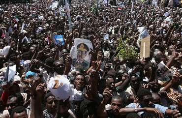 A crowd supporting Sudan's President Omar Hassan al- Bashir chants slogan during a protest in Khartoum