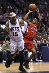 Toronto Raptors guard Ford is fouled while shooting by New Jersey Nets guard Carter in East Rutherford