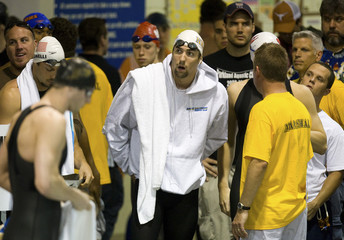 Swimmer Phelps looks around as he prepares to swim in prelim race of 100 meter freestyle during Charlotte UltraSwim Grand Prix in Charlotte