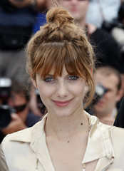 """French director Laurent reacts during a photocall for her film """"De Moins en Moins"""" in Cannes"""