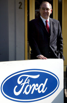 FORD AG CEO ZIMMERMANN POSES BEHIND A LOGO PRIOR TO THE ANNUAL NEWSCONFERENCE IN COLOGNE.