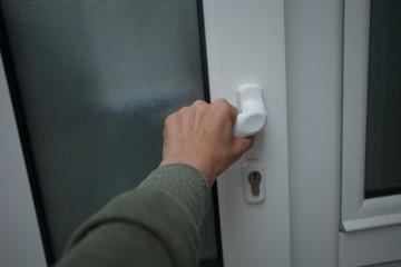 woman hand open door