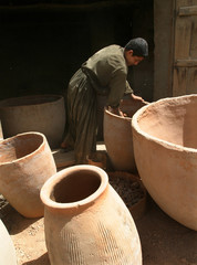 AFGHAN BOY WORKS ON A LOCAL TANDOOR OVEN IN KABUL.