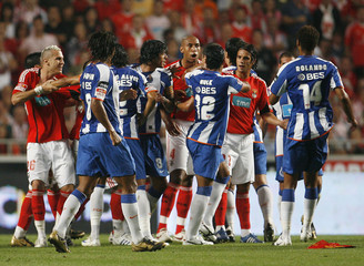 Benfica and Porto players fight during their Portuguese Premier League soccer match at Luz stadium in Lisbon