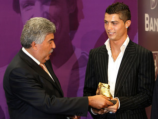 Portugal's soccer player Ronaldo receives the European Golden Boot award from Portuguese sport paper director Serpa during a ceremony on Madeira island