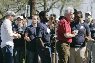 Former U.S. President Clinton and Pitt greet volunteers in New Orleans