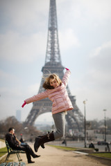 Adorable little girl jumping in Paris background the Eiffel tower in France