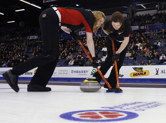 Ontario lead Andra Harmark and third Kirsten Wall sweep a rock in their Draw 3 match against Saskatchewan at the 2008 Scott Tournament of Hearts in Regina.