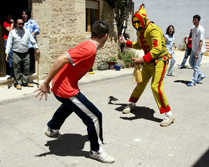 MAN DRESSED AS EL COLACHO IS CHASED DURING CORPUS CHRISTI RITUAL INNORTHERN SPAIN.