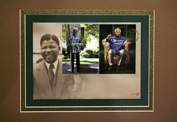 Postage stamps issued by the South African Post Office to celebrate former President Nelson Mandela's 90th birthday are pictured during its launch in Houghton