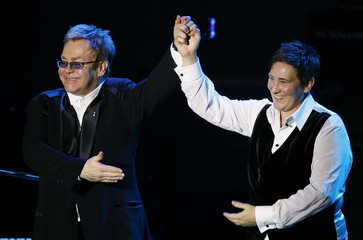 "Musician K.D. Lang and Elton John thank the crowd after performing during the ""An Enduring Vision"" benefit for the Elton John AIDS foundation in New York"