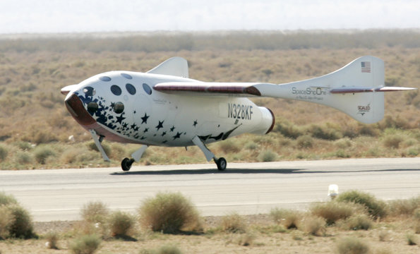 SPACESHIPONE TOUCHES DOWN AFTER HISTORIC FLIGHT TO THE EDGE OF OUTER SPACE.