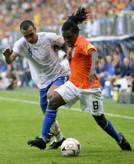 Drenthe of the Netherlands challenges Jan of Israel during the opening match of the European Championship under 21 in Heerenveen