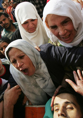Relatives of Hani Semadi cry over his body during funeral near Jenin