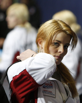 Denmark's Jensen leaves with her teammates after her team was defeated by China during the 2009 World Women's Curling Championship in Gangneung