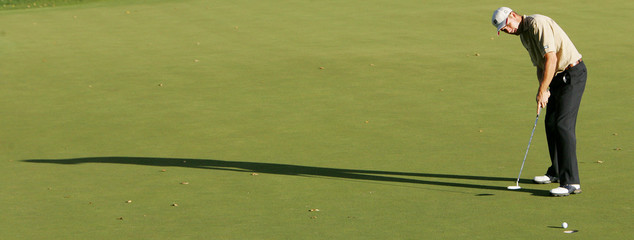 Ireland's Harrington putts the ball on the 18th green during the WGC-American Express ...