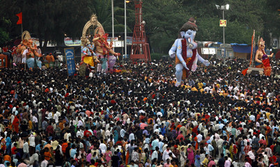 Devotees carry statues of Hindu elephant god Ganesh for immersion in sea in Mumbai