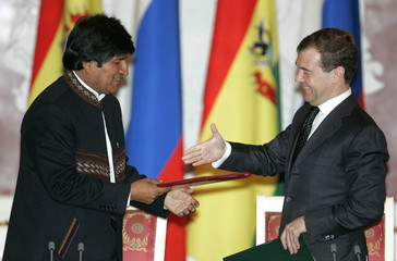 Bolivia's President Evo Morales and Russia's President Dmitry Medvedev shake hands after signing documents in Moscow