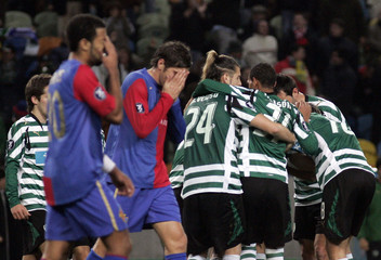 Sporting players celebrate their goal beside dejected Basel players during their UEFA Cup soccer match in Lisbon