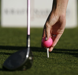 Paula Creamer places her pink Precept Tour ball on the tee in Rancho Mirage