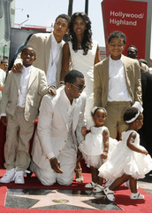Combs poses with family after receiveing a star on the Hollywood Walk of Fame in Hollywood
