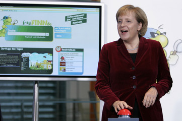 German Chancellor Merkel pushes a buttom to inaugurate the new secure internet platform for children at the Chancellery in Berlin