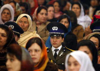 Afghan women attend a ceremony to mark International Women?s Day in Kabul