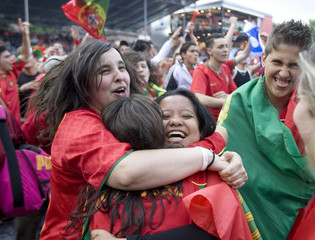 """Portugal fans celebrate their team's victory after the Euro 2008 soccer match against Czech Republic at a """"fan zone in Basel"""