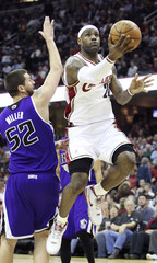 Cleveland Cavaliers James puts up shot around defense of Sacramento Kings Miller during their NBA basketball game in Cleveland