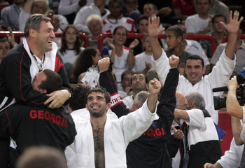 Georgia's men's Judo team celebrate after beating Russia in the final of the World Championship by Team of Nations competition in Paris