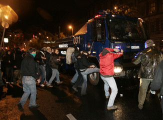 Right wing protesters attack a police vehicle during an anti-government demonstration in Budapest